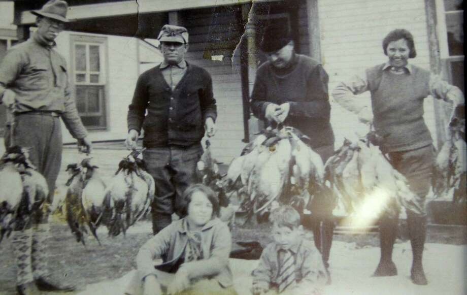 A photo of Port Bay Hunting and Fishing Club members from the early years of the century-old club show the abundance of waterfowl that drew hunters to the area and the family-oriented focus of the club's members.  Photo courtesy Port Bay Club. Photo: Picasa, Shannon Tompkins/Chronicle