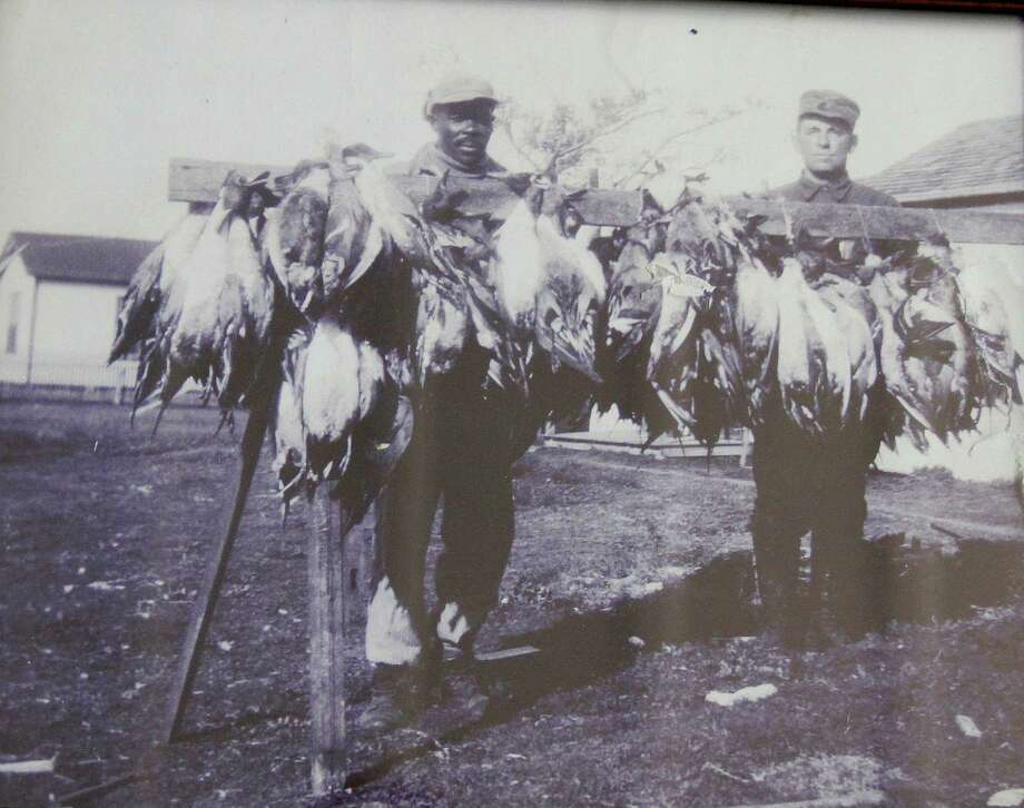 Port Bay Club hunting guides with ducks - almost exclusively pintails - taken by club members in the early 1900s when bag limits were 25 ducks per day. Photo courtesy of Port Bay Club. Photo: Picasa, Shannon Tompkins/Chronicle