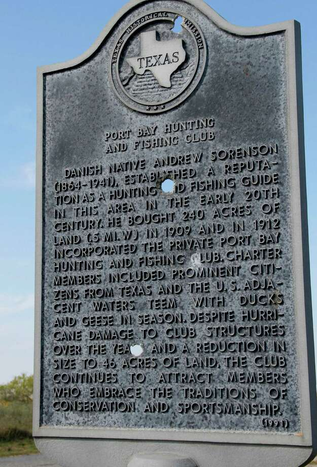 "A Texas Historical Commission marker notes the origin and history of the Port Bay Hunting and Fishing Club, the oldest continuosly operated private ""sportsman's"" club on the Texas coast. Photo: Picasa, Shannon Tompkins/Chronicle"