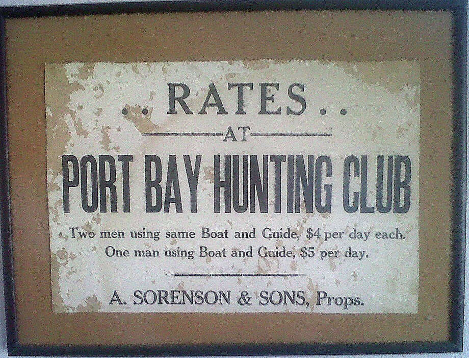 "This notice of the rates for waterfowl hunters using the Port Bay Hunting Club dates to the early 1900s. The private club, which was created in 1912, is the oldest continuously operated such ""sportsman's"" club on the Texas coast, and, arguably, in the entire state. Photo courtesy of Ed Duvall. Photo: Picasa, Shannon Tompkins/Chronicle"