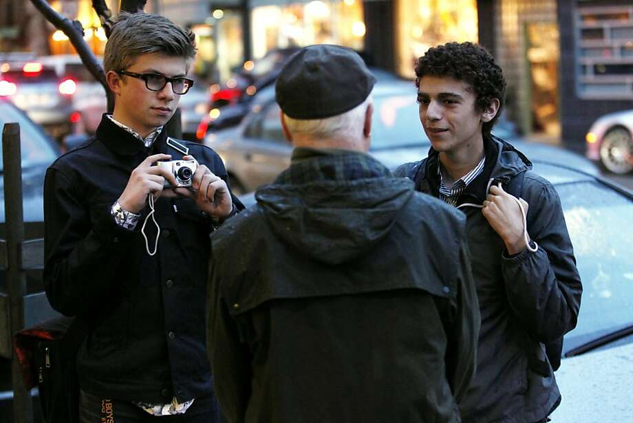 Noah Goldstein (right) and Owen Smith-Clark, both of Oakland, ask people on the street if they think Piedmont should be returned to Oakland on Friday, November 16, 2012 in Oakland, Calif. Photo: Beck Diefenbach, Special To The Chronicle