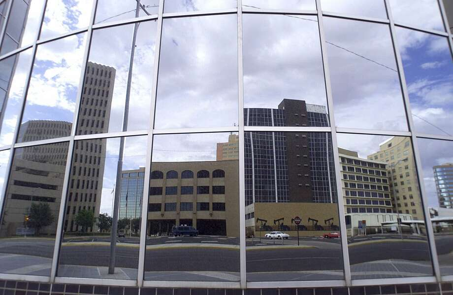 The Midland, Texas, skyline is reflected in the windows of The Summit building in downtown Mildand Monday, July 2, 2001. Photo: LARA MECKFESSEL, AP / ODESSA AMERICAN