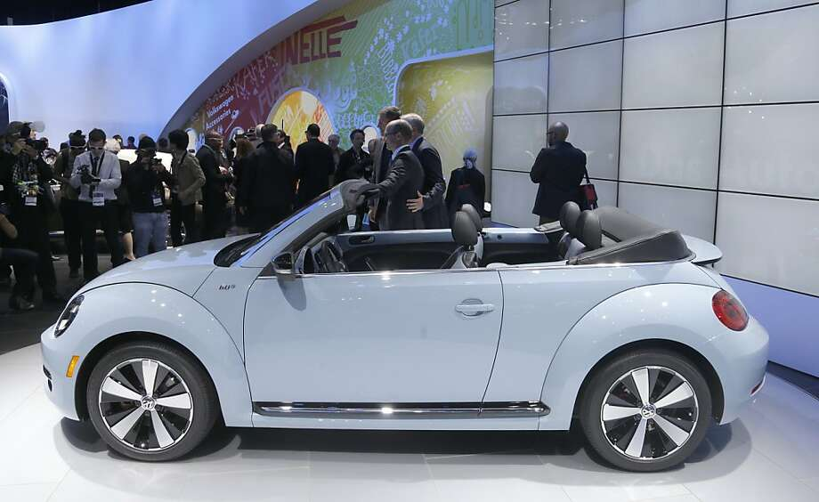 Volkswagen Beetle convertible is shown during its world debut at the LA Auto Show in Los Angeles, Wednesday, Nov. 28, 2012. The annual Los Angeles Auto Show opened to the media Wednesday at the Los Angeles Convention Center. The show opens to the public on Friday, November 30. (AP Photo/Chris Carlson) Photo: Chris Carlson, Associated Press