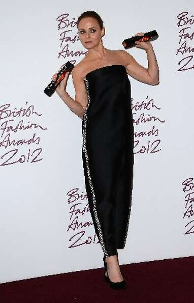 Stella McCartney  winner of Designer of the Year poses in the awards room at the British Fashion Awa