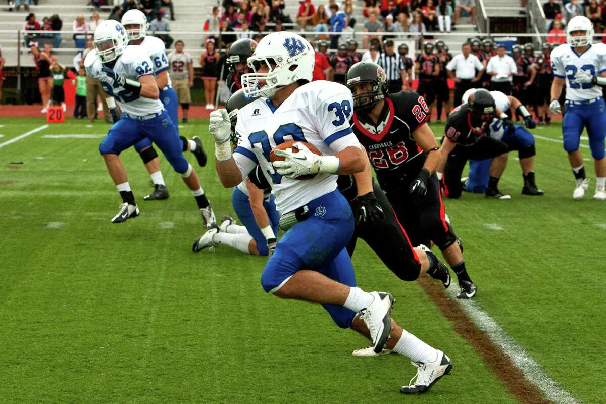 Former Brunswick Bruin star Joe Beninati, No. 38, recently completed his first season as a running back for the Division III Washington and Lee Generals. Here he carries the ball against the Catholic University Cardinals.
