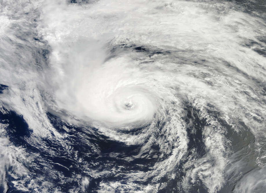 HURRICANE CHRIS: This storm was the first hurricane of the Atlantic season, but its hurricane status lasted only six hours and petered out in the ocean, without impacting land or people. Above, the storm in the  Atlantic Ocean on June 21, 2012. Photo: .