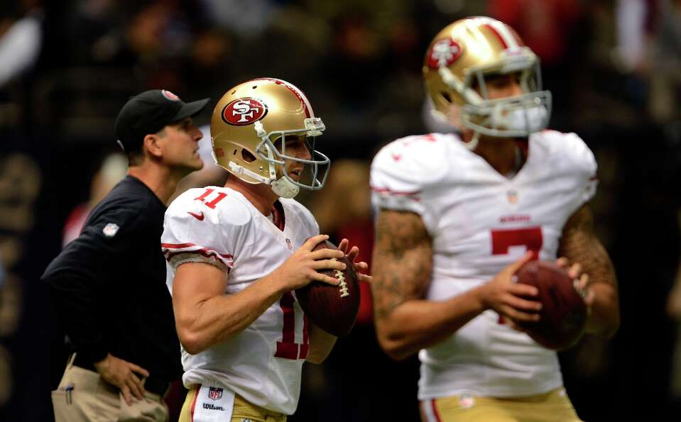 San Francisco 49ers quarterback Colin Kaepernick (7) and quarterback Alex Smith (11) warm up before