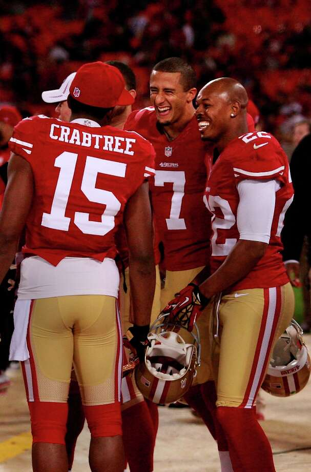 Colin Kaepernick shared a light moment near the end of the game with Michael Crabtree 15 and Carlos Rogers 22. The San Francisco 49ers defeated the Chicago Bears 32-7 at Candlestick Park Monday November 19, 2012. Photo: Brant Ward, The Chronicle / ONLINE_YES