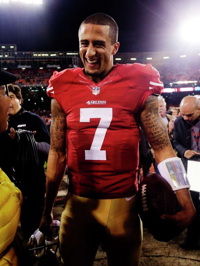 San Francisco 49ers quarterback Colin Kaepernick (7) smiles at the end of their 32-7 win over the Chicago Bears in an NFL football game in San Francisco, Monday, Nov. 19, 2012. Photo: Marcio Jose Sanchez, Associated Press / AP