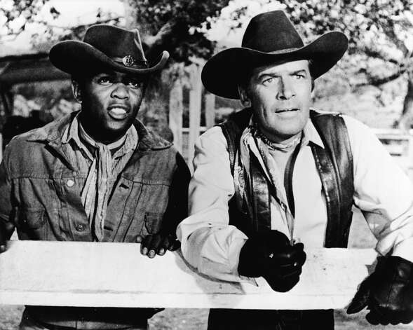"Peter Breck, 82, died Feb. 2. He appeared in ""The Big Valley"" and ""Maverick,"" as well as other programs. He's pictured above with soul singer and Big Valley guest star Lou Rawls. Photo: Hulton Archive, Getty Images / 2005 Getty Images"