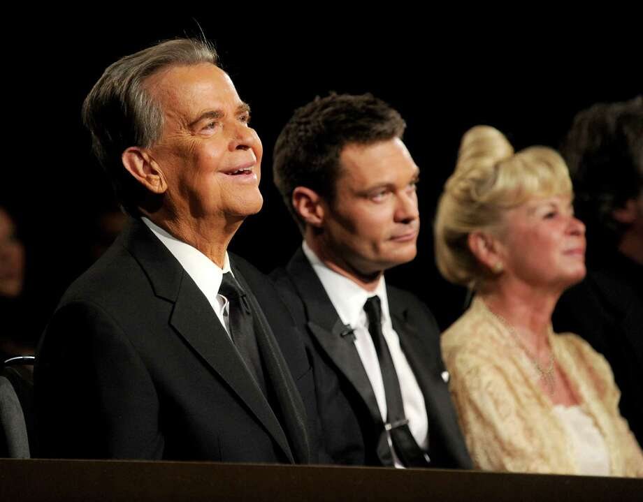 "Dick Clark, 82, died April 18. The longtime face of ""American Bandstand,"" Clark also counted down the clock on New Year's Eve from Times Square. Clark, left, is pictured above with heir apparent Ryan Seacrest and Kari Clark. (Kevin Winter / 2010 Getty Images) Photo: Kevin Winter, Getty Images For ATI / 2010 Getty Images"