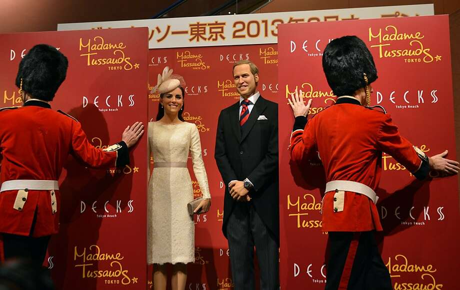 "Sadly, there is no wax 'naked Harry in Vegas' figure: ""Buckingham Palace guards"" unveil wax figures of Prince William and Kate in Tokyo in advance of next year's reopening of Madame Tussauds waxwork museum. Photo: Yoshikazu Tsuno, AFP/Getty Images"