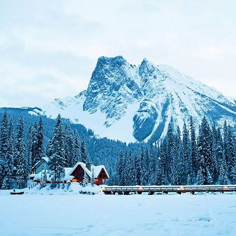 Emerald Lake Lodge, Field, B.C.: High in the Canadian Rockies, Emerald Lake Lodge won't provide you with email, cell service, or in-room TV. Instead, it gives you deep, soft snows on a 13-acre peninsula jutting out into Emerald Lake. In the main lodge—a hand-hewn timber structure that dates back to 1902—you'll play pool by the fireplace, drink at an oak bar salvaged from a 19th-century Yukon saloon, then sup on dishes like duck breast and hazelnut risotto. When it's time to turn in, you'll sleep in one of 24 two-story cabins, each with a balcony and stone fireplace. Local activities include cross-country skiing, downhill at nearby Lake Louise, and ice-skating on Emerald Lake. From $203 U.S.; crmr.com/emerald Read more: 18 great snowy getaways