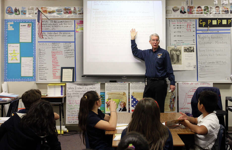 Retired U.S. Air Force Colonel Charles Holsen teaches fifth-grade bilingual class at Esparza Elementary School, Monday, Nov. 26, 2012. Holsen spent 26 years in the air force and started teaching 15 years ago with assistance from the federal program, Troops to Teachers. Photo: Jerry Lara, San Antonio Express-News / © 2012 San Antonio Express-News