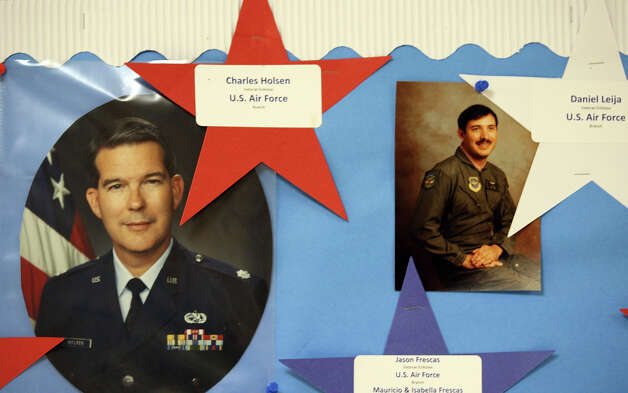 Photos of retired U.S. Air Force Col Charles Holsen, left, and retired Air Force medic Dan Leija are part of a Veterans Wall at Esparza Elementary School, Monday, Nov. 26, 2012. Holsen and Leija went through the federal program Troops to Teachers and now teach at the school. Photo: Jerry Lara, San Antonio Express-News / © 2012 San Antonio Express-News