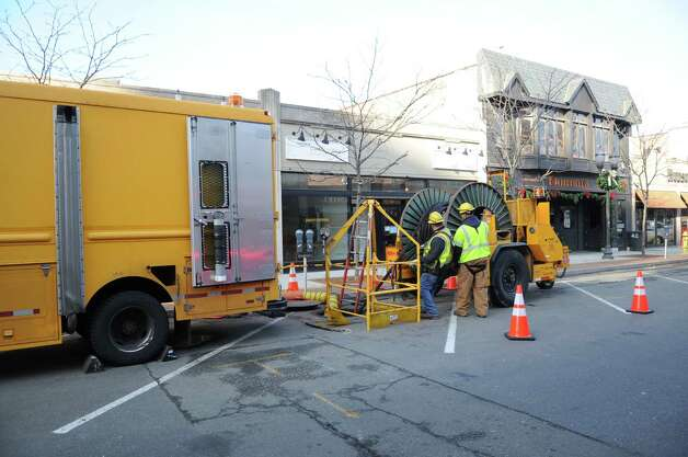 Connecticut Light and Power works on Bedford Street on Wednesday, November 28, 2012, near the Ferguson Library where an underground electrical vault exploded Tuesday night. Photo: Lindsay Niegelberg / Stamford Advocate