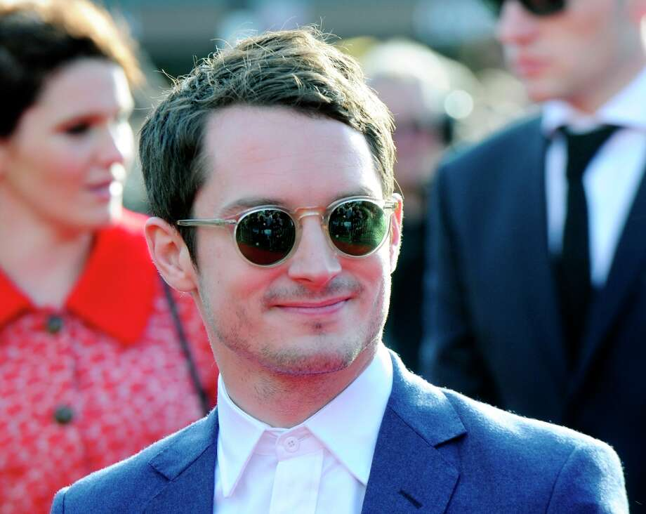 Cast member Elijah Wood poses on the red carpet at the premiere of The Hobbit: An Unexpected Journey,  at the Embassy Theatre, in Wellington, New Zealand, Wednesday, Nov. 28, 2012.  (AP Photo/SNPA, Ross Setford) Photo: Ross Setford, Associated Press / SNPA