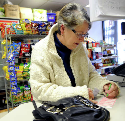 "Barbara Stamatelos picks Powerball numbers at Belltown Variety on Wednesday, November 28, 2012. Stamatelos said she played some numbers that ""seem to always come up"" and some birthdays. ""I never play, but this is so tempting,"" she said. Stamatelos said she doesn't have any plans for the money if she won. ""I wouldn't know what to do with it,"" she said, ""I couldn't imagine."" Photo: Lindsay Niegelberg / Stamford Advocate"