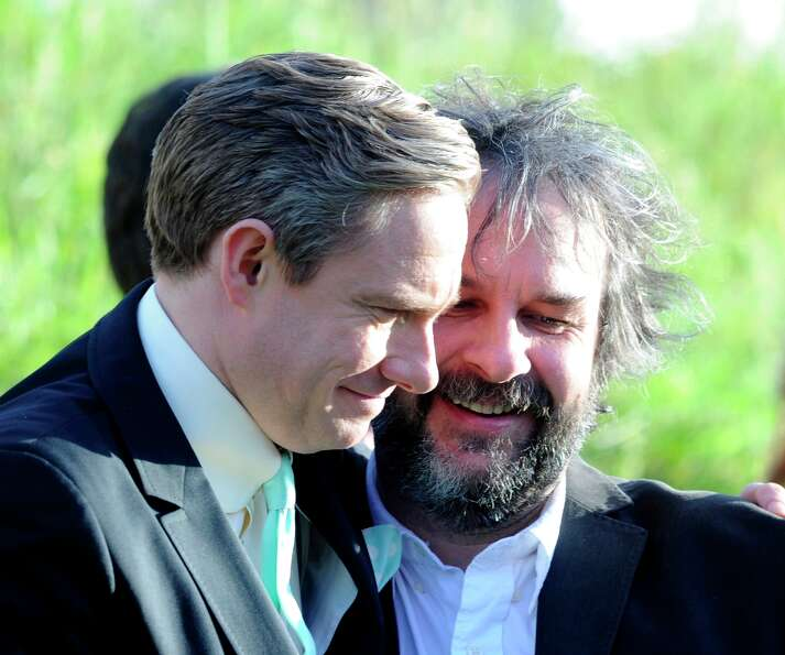 Cast member Martin Freeman, left, embraces director Peter Jackson at the premiere of The Hobbit: An