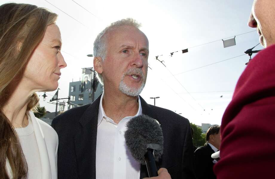 Director James Cameron (C) and Suzy Amis (L) speak to the media upon their arrival at the world premiere of The Hobbit movie in Courtenay Place in Wellington on November 28, 2012.  Marty Melville/AFP/Getty Images Photo: MARTY MELVILLE, AFP/Getty Images / AFP