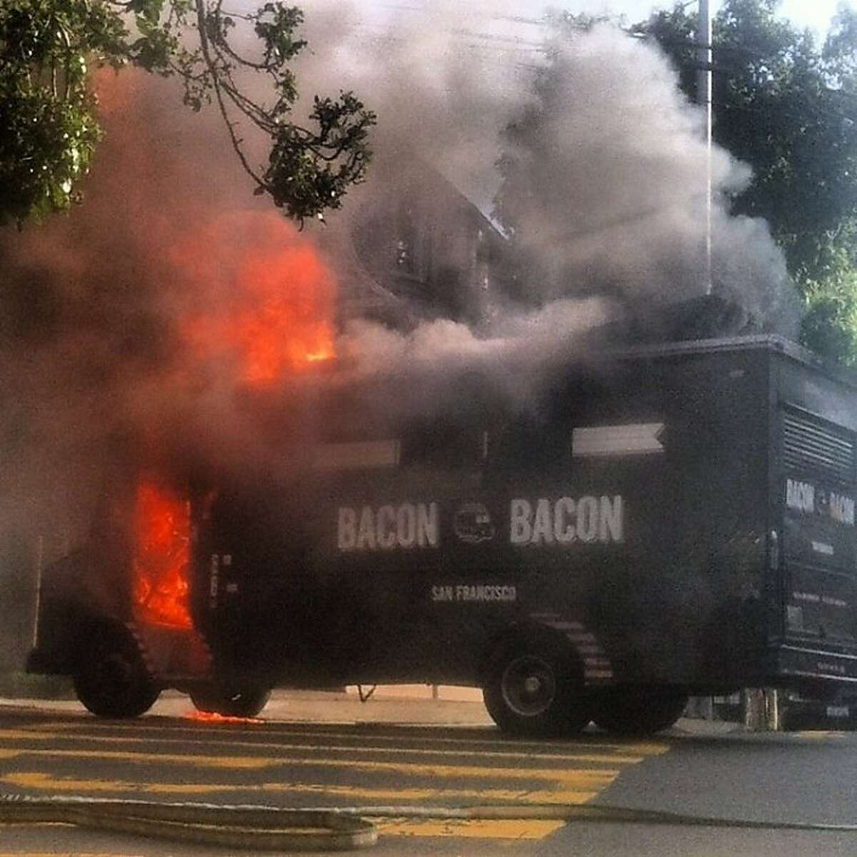 The Bacon Bacon truck catches on fire on Nov. 21, 2012 in San Francisco.