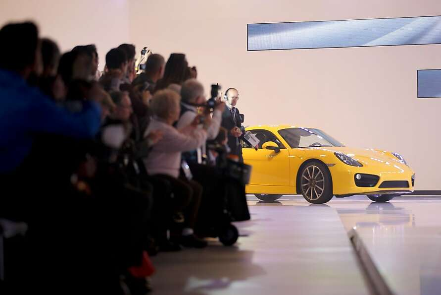The new Porsche Cayman is introduced at the LA Auto Show in Los Angeles, Wednesday, Nov. 28, 2012. T