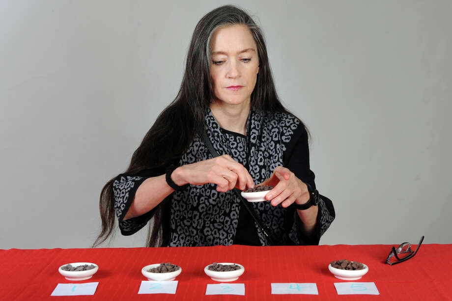 Alison Boteler samples chocolate chips during a taste test in Bridgeport, Conn. Nov. 15th, 2012. Photo: Ned Gerard / Connecticut Post