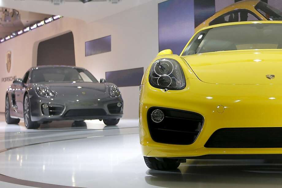 The new Porsche Caymans are introduced at the LA Auto Show in Los Angeles, Wednesday, Nov. 28, 2012. (AP Photo/Jae C. Hong) Photo: Jae C. Hong, Associated Press