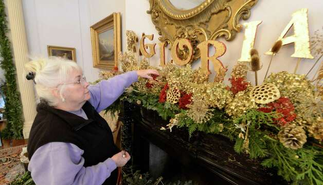 Patty Bligh of the Van Rensselaer Garden Club puts the finishing touches on a display above one of the fire places at the Rensselaer County Historical Society in Troy, N.Y. Nov 27, 2012 for the 56th Annual Holiday Green Show.      (Skip Dickstein/Times Union) Photo: Skip Dickstein / 00020259B