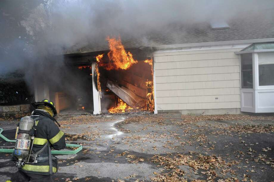 Firefighters responding to a garage fire at 58 Knollwood Lane on Nov. 19. Photo: Contributed