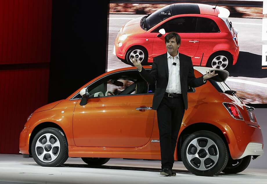 Olivier Francois, Chrysler's chief marketing officer and global chief of the Fiat brand, talks in front of a Fiat 500e at the LA Auto Show in Los Angeles, Wednesday, Nov. 28, 2012. The annual Los Angeles Auto Show opened to the media Wednesday at the Los Angeles Convention Center. The show opens to the public on Friday, November 30. Photo: Chris Carlson, Associated Press