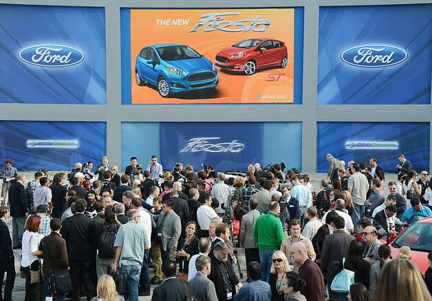 The 2014 Ford Fiesta draws a crowd as it is unveiled at the 2012 Los Angeles Auto Show in Los Angeles, California on media preview day, November 28, 2012.   The LA Auto Show will open to the public on November 30 and runs through December 9. Photo: Robyn Beck, AFP/Getty Images