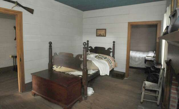 "The first room you enter is this Master Bedroom of John and Sally French. There is not a lot of furniture, but there is the bed and hope chest, a sewing machine, two small chairs and the fireplace. The John Jay French Museum, which is the oldest fully restored standing two story home in Beaumont, is built in the ""dogtrot"" style where all the rooms except the kitchen area is off a main hallway at the left. The home was built in 1845, has seven rooms, and takes about an hour to tour.  Dave Ryan/The Enterprise"