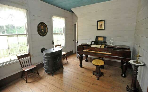 The Parlor was off limits to children in the French home. Atop the piano  sits this 1811, still-working music box owned by Mr. French. The room also has a vintage heater vented through the wall.  The John Jay French Museum, which is the oldest fully restored standing two story home in Beaumont, was built in 1845, has seven rooms, and takes about an hour to tour.  Dave Ryan/The Enterprise