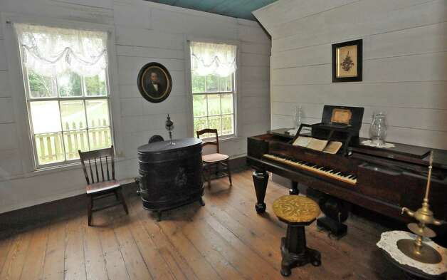 The Parlor was off limits to children in the French home. Atop the piano  sits an1811, still-working music box owned by Mr. French. The room also has a vintage heater vented through the wall.  The John Jay French Museum, which is the oldest fully restored standing two story home in Beaumont, was built in 1845, has seven rooms, and takes about an hour to tour.  Dave Ryan/The Enterprise