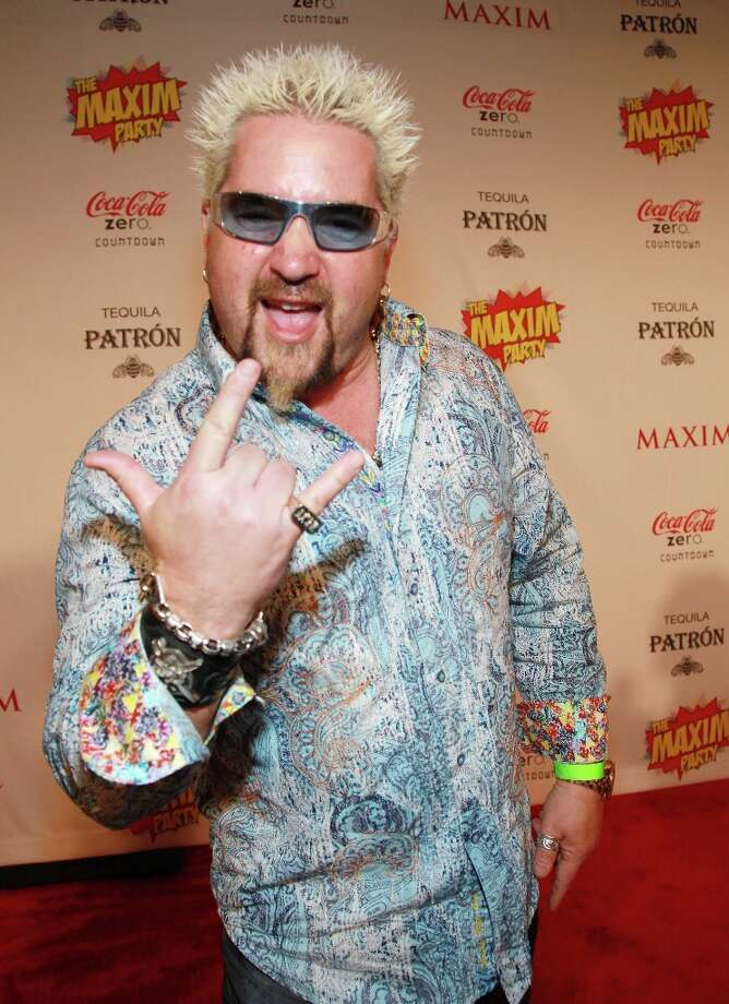 First celeb chef Guy Fieri's Time Square restaurant gets eviscerated by the NY Times, now this. Photo: John W. Ferguson / 2012 Getty Images