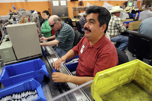 Raul Gamez, 42, assembles pens at the San Antonio Lighthouse for the Blind, Tuesday, Nov. 27, 2012. The non-profit makes several items, from pens to military cargo nets, for government and non-government contracts. Seventy-five percent of its workforce is legally blind. Photo: Jerry Lara, San Antonio Express-News / © 2012 San Antonio Express-News
