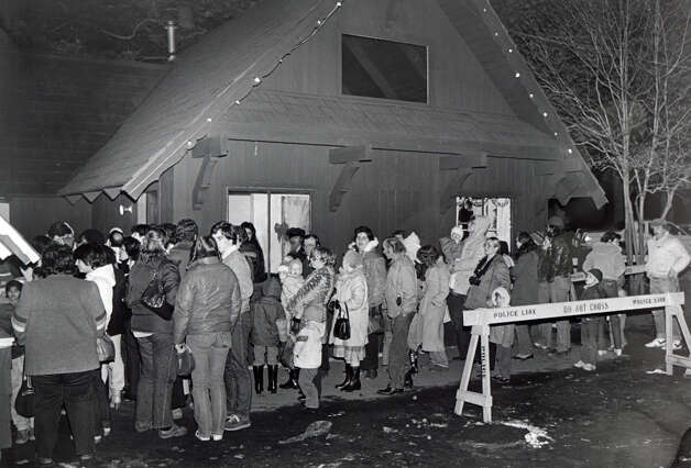 Crowds wait in line to enter the PAL Christmas Village, in Bridgeport, Conn. in December, 1982. The Christmas Village reopened just days after being damaged by a fire on Dec. 7th. Photo: File Photo / Connecticut Post File Photo