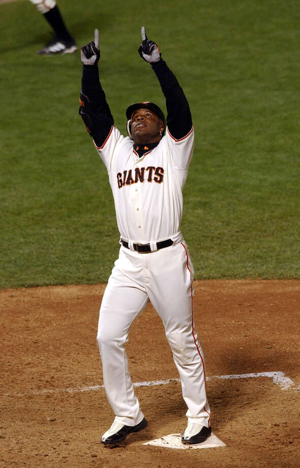 San Francisco Giants' Barry Bonds reacts as he touches home plate after hitting his 600th career home run, a solo shot off of Pittsburgh Pirates pitcher Kip Wells during the sixth inning at Pacific Bell Park in San Francisco, Friday, Aug. 9, 2002. (Marcio Jose Sanchez / AP) Photo: MARCIO JOSE SANCHEZ, ASSOCIATED PRESS / ONLINE_YES