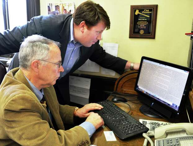 "Executive director of the Troy Public Library Paul Hicok, left, and Tom Nardacci of Gramercy Communications call up the digitized version of  ""T'was the Night Before Christmas"" in The Troy Sentinel newspaper of Dec. 23, 1823 at the library Wednesday Nov. 14, 2012. (John Carl D'Annibale / Times Union) Photo: John Carl D'Annibale / 00020102A"