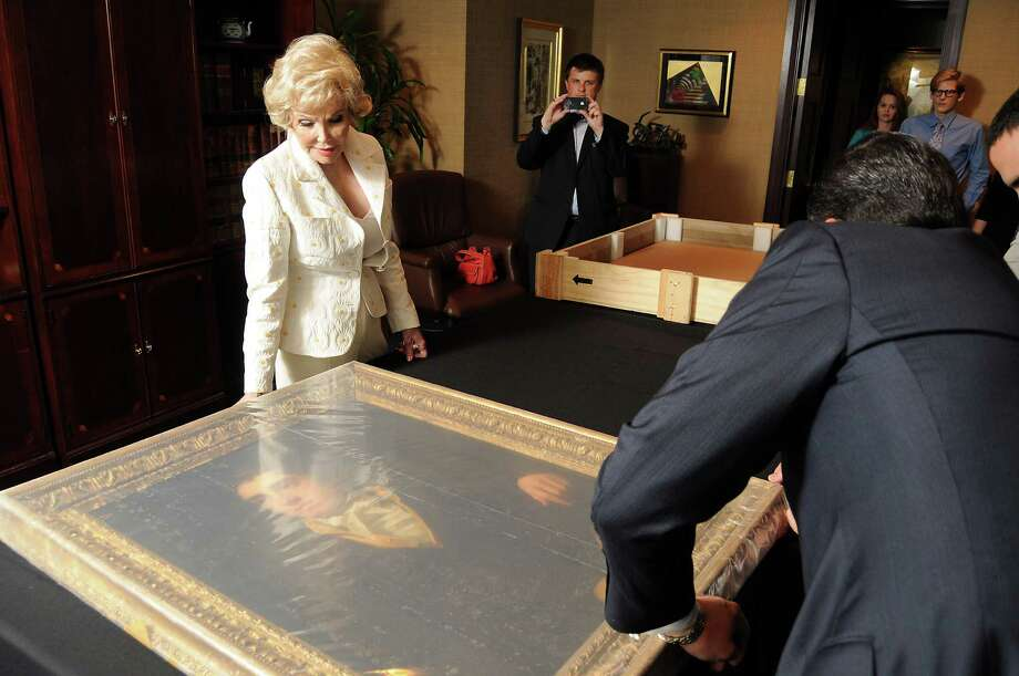 Joanne King Herring looks at her recovered Sir Henry Raedurn painting that was stolen in 1986 and recovered in 2009. Photo: Dave Rossman, Freelance / © 2011 Dave Rossman