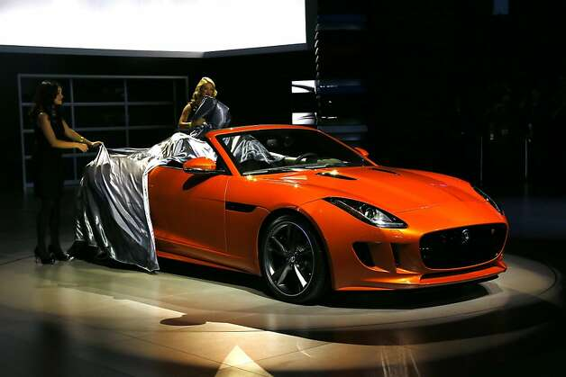 The all-new F-TYPE with special-order Firesand paintwork and equipped with optional 'Design' and both exterior and interior 'Black' packs, made its Auto Show debut at the LA Auto Show on November 28, 2012 in Los Angeles, California. Photo: Neilson Barnard, Getty Images For Jaguar Land Rov