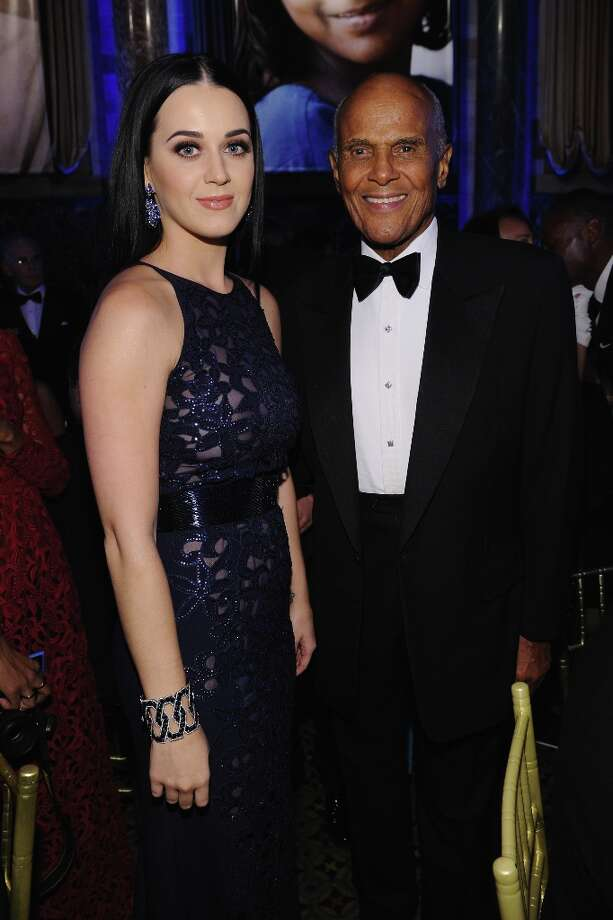 Katy Perry and Harry Belafonte attend the Unicef SnowFlake Ball at Cipriani 42nd Street on November 27, 2012 in New York City.  (Photo by Bryan Bedder/Getty Images) Photo: Bryan Bedder, Getty Images / 2012 Getty Images