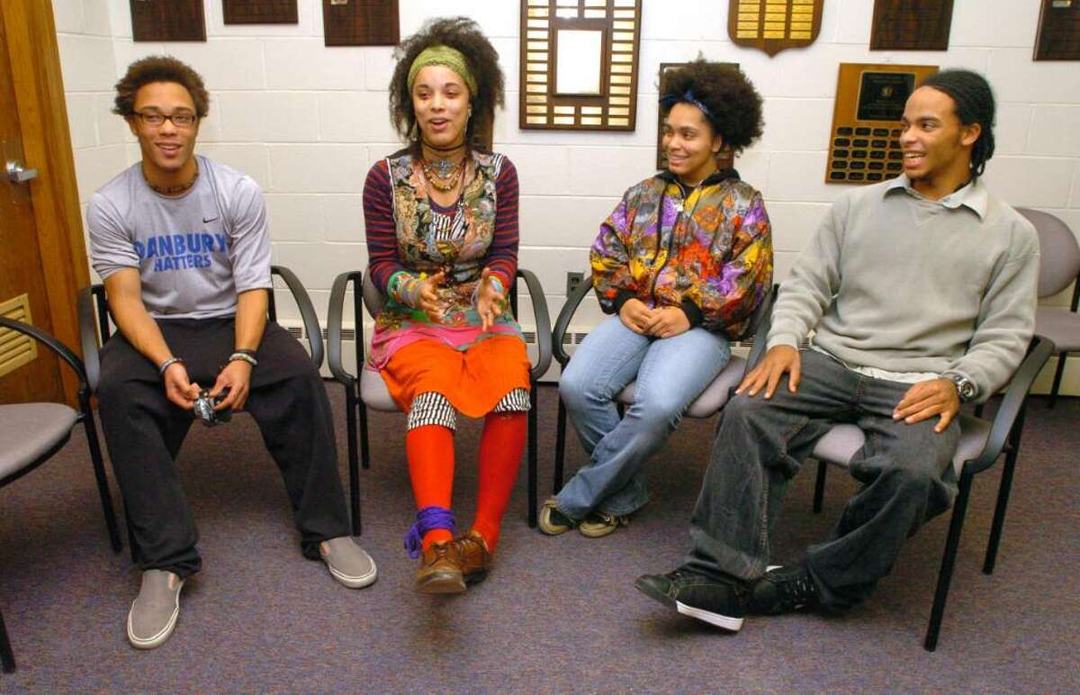 From left, Ray, Martina, Carol and Kenneth Crouch, all 18 and who are quadruplets attending Danbury High School talk about their acceptance to Yale at school Thursday, Dec. 17, 2009.