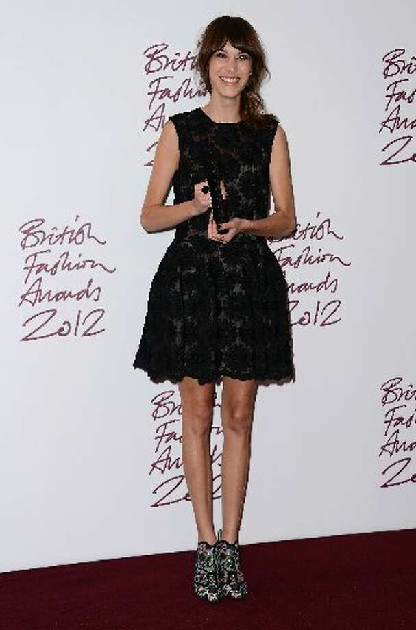 Alexa Chung, winner of the British Style award supported by Vodafone, poses in the awards room at the British Fashion Awards 2012 at The Savoy Hotel on November 27, 2012 in London, England. (Photo by Ian Gavan/Getty Images)