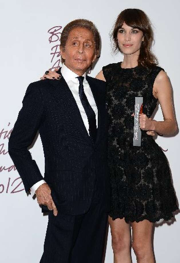 Presenter Valentino Garavani and Alexa Chung, winner of the British Style award supported by Vodafone, poses in the awards room at the British Fashion Awards 2012 at The Savoy Hotel on November 27, 2012 in London, England. (Photo by Ian Gavan/Getty Images) (Getty)