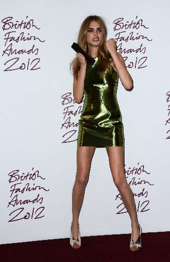Cara Delevingne, winner of the Best Model award poses in the awards room at the British Fashion Awards 2012 at The Savoy Hotel on November 27, 2012 in London, England. (Photo by Ian Gavan/Getty Images)