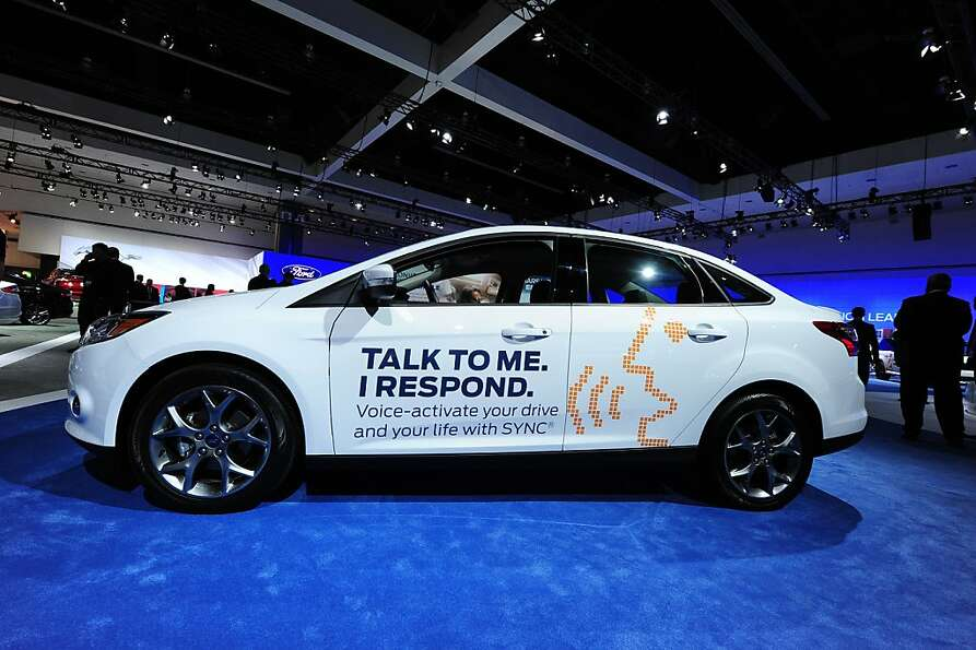 A Ford Focus SE advertises its SYNC capability at the Los Angeles Auto Show in Los Angeles, Californ