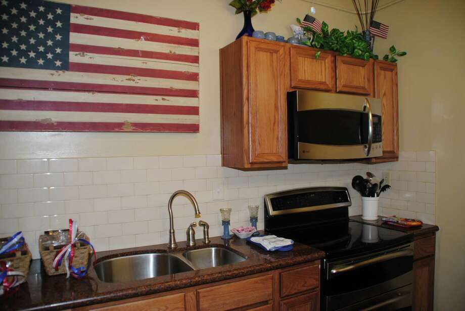 The community kitchen area at The De George at Union Station, a homeless vet facility, received a remodel by HomeAid Houston and Darling Homes.