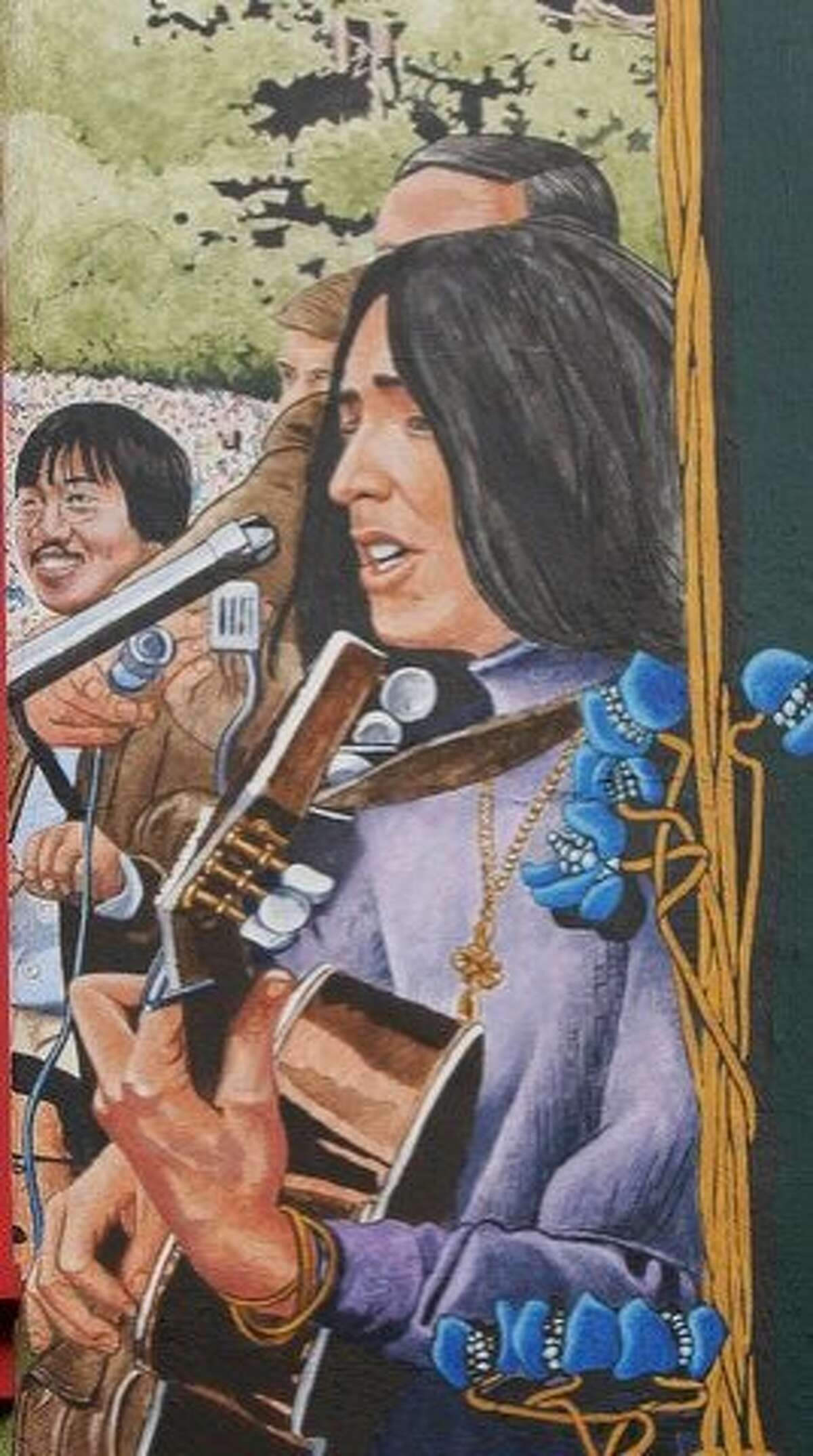 Part of a Haight Street mural by Bill Weber shows Joan Baez and, left, Ben Fong-Torres.